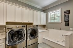 This is the Best Pet Washing station I have seen in awhile, elevated just enough and big for large dogs.  Traditional Laundry Room by Emerald Coast