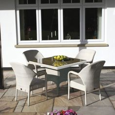 Set Includes: 1 x Sussex Square Dining Table with Parasol Hole inc. Glass 4 x Sussex Stackable Armchairs Dimensions: Table - Armchair - Back Seat Material:Soft White WeaveOff White Fine/Modern round weave Optional Cushions:Waterproof Pistachio Cushions Garden Dining Set, Garden Table And Chairs, Outdoor Dining Set, Outdoor Tables, Outdoor Decor, Luxury Garden Furniture, Dining Furniture, Outdoor Furniture Sets, Square Dining Tables