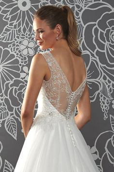 The V neck on this style will draw the eye in, slimming the figure while the straps offer support and comfort. The delicate beaded back will wow guests as you walk down the aisle. Prices...