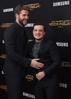"Liam Hemsworth (L) and Josh Hutcherson attend ""The Hunger Games: Mockingjay- Part 2"" New York Premiere at AMC Loews Lincoln Square 13 theater on November 18, 2015 in New York City."