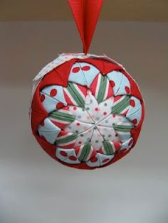 Folded fabric ornaments - they look quilted, but they're not. Just fold and pin.  You need 2.5 in squares... and you can use up a lot of remnants this way!