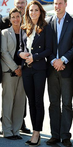 ALL BUTTONED UP  Kate goes from princess to preppy in a gold-buttoned navy Smythe blazer, ruffled top, J Brand jeans and wedge espadrilles to board a plane with her coordinating husband.