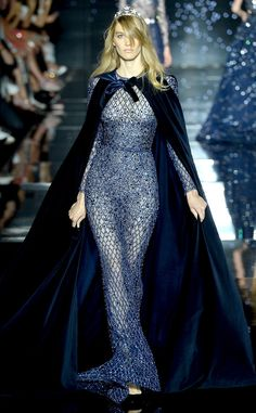 Zuhair Murad Haute Couture Fall 2015: Dramatic and starry night! I love the sheet netting fabric with the embellishments. The blue colors is gorgeous! The cape adds drama!