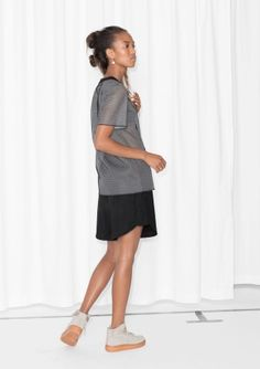 CAPSULE COLLECTION Clean-cut and understated, this mesh t-shirt is a fusion of luxed-up sportswear and versatile ready-to-wear.