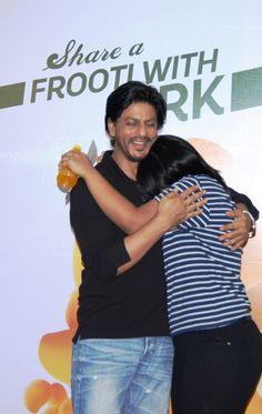 Shah Rukh Khan hugging a fan