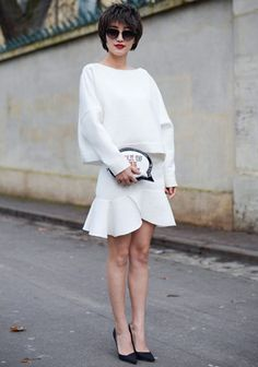 When in doubt, a boxy white pullover and matching miniskirt always work well together. Click though to shop the look.