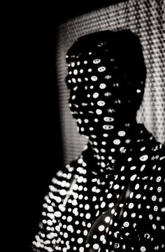Silhouette of Man with Dots, © Ralph Gibson, black & white photo.