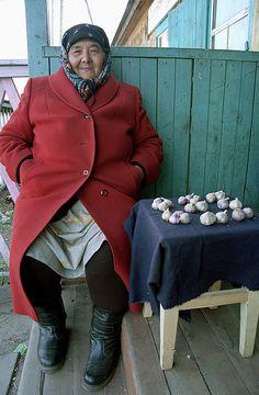 Evenk babushka selling garlic, Ukraine