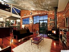 brick wall, ceiling height, metal roofing, lighting chains