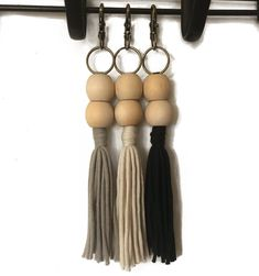 Add some extra style to your bag with our Grace Chain.   Perfect as a bag charm, keychain, zipper pull - or for any place you just want to play with those flowing tassels 😊  We've made these with bronze coloured lobster clasps so they can be added & removed easily ❤️  Now available online.  #hamont #burlon #locallove #bagcharm #zipperpull #tassel #tassellove #handmade #keychains #keychain #bohochic #thegracechain #bagstyle #simplestyle #etsylovers #summerstyle #bohostyle… Fashion Bags, Boho Fashion, Handmade Keychains, Zipper Pulls, Simple Style, Boho Chic, Tassels, Bronze, Drop Earrings