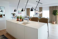 View the full picture gallery of The Carlsberg City - Bohrs Tower Kitchen Lamps, Black And White Marble, Cool Kitchens, Lighting Design, Living Area, Dining Table, Tower, Interior Design, City