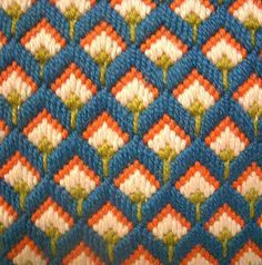 This is a great little bargello needlepoint pillow. Colors in teal, orange, light pink and lime green. Back of pillow made in small wale corduroy fabric. Measures 10 1/2 inches square. Very good workmanship and in great vintage condition.