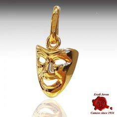 "COMEDY MASK CHARM PLAIN YELLOW GOLD  Gold dangle mask of comedy charm to hang both on a chain both on a bracelet. Absolutely the first shape of mask in theater's history. Originally used for sacred rites, over time became the device to hide his own face during Carnival, period of ""immorality"" and excesses.  https://www.eredijovon.com/en/2692-comedy-mask-charm-plain-yellow-gold.html"