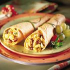 Chicken and Cherry Wraps - A delicious, chicken sandwich spread with dried cherries, finely chopped cucumber, shredded carrot and sliced green onions in a curry-lemon yogurt dressing is served wrapped up in warm, whole wheat flour tortillas. A great recipe for leftover turkey, too!