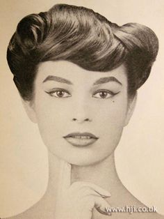 1957 wide swirls hairstyle        Hairstyle by: Henry Prevost  Location: Paris