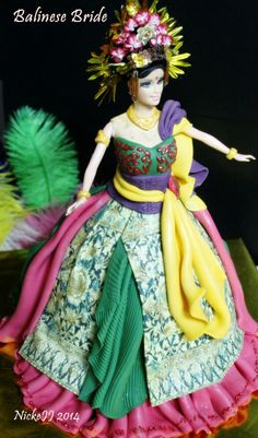 http://aucoindemacuisine.wordpress.com/2014/02/22/balinese-bride-barbie-doll-cake/