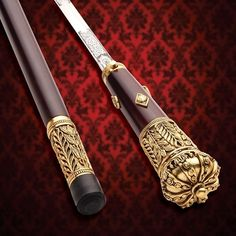 This sword cane is adorned in antiqued gold and worthy of Her Majesty's Service. Featuring the Windlass locking mechanism and a stainless steel blade. Wooden Walking Canes, Wooden Walking Sticks, Walking Sticks And Canes, Metal Jewelry, Jewelry Art, Jewelry Design, Cane Sword, Handmade Walking Sticks, Homemade Weapons