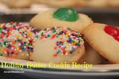 Holiday Butter Cookie Recipe; these simple, four ingredient Holiday Butter Cookies are absolutely delicious! They can be decorated with nuts, sprinkles, cherries and more. You are only limited by your imagination.
