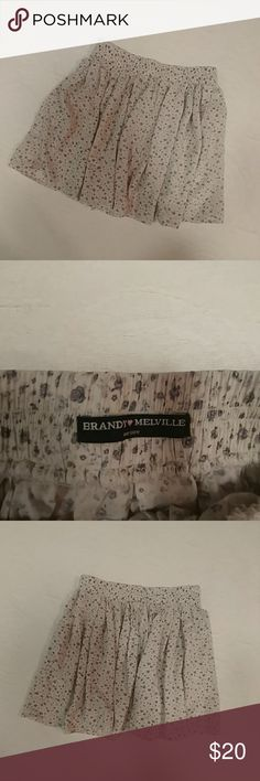 Brandy Melville Grey Floral Skater Skirt Adorable skirt from Brandy Melville! Grey floral print on a cream background with an elastic waist! One size, would fit an xs or s.  Item is in excellent used condition! Offers and bundles always welcome! Brandy Melville Skirts Circle & Skater