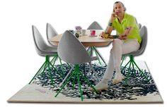 Karim Rachid's chairs for Bo concept, love the abstract rug against the green legs of the chair...