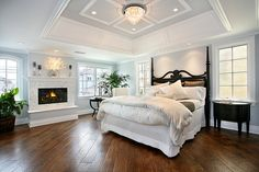 Clean bright bedroom w/ dark wood floors