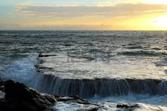 panoramic beach: Wonderful seascape at Nui Chua national park, Ninh Thuan, Viet Nam, waves on large rock and make amazing fall in Hang Rai at sunrise, amazing landscape at Vietnam beach, masterpiece place for travel Stock Photo