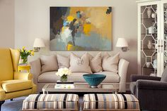 Before and After Family Room by Tobi Fairley   Another beautiful appropriately-sized piece of art over the sofa.