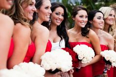 Bridesmaids in red with white bouquets.  I want my bridesmaids to be in red dresses, with white flowers and details