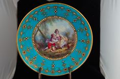 """The porcelain century, the decoration century Finely painted after Boucher with an amorous couple in landscape, the rim richly """"jeweled"""" with faux rubies and pearls 8 in. Cup And Saucer, 18th Century, Art Museum, Porcelain, Turquoise, Jewels, Antiques, Painting, Decor"""
