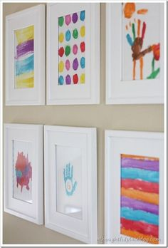 love this idea of using kids drawings and paintings as art on your gallery wall.