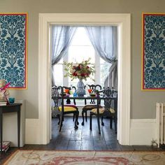 Love how modern the traditional chairs are made to look more modern; the use of wall paper; and if need to build a wall to separate the dining room, then I like the wide molding used here to frame the doorway