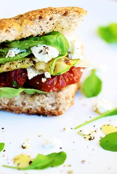 Mini-sandwich with sundried tomatoes appetizer, basil and zucchini