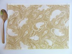 small paisley rat pattern. White and tan colours