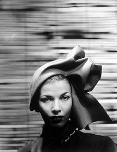 Christian Dior by Erwin Blumenfeld, Vogue, March 1950.