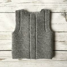 This baby vest is made from of wool, acrylic yarn. It features four buttons for closure The waistcoat is warm, cosily soft and comfortably lightweight. Pictured color: gray Please select desired color and size. Made to order. The baby vest will be Baby Knitting Patterns, Baby Patterns, Diy Bebe, Knit Vest, Easy Knitting, Baby Booties, Pulls, Etsy, Clothes