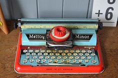 Vintage  tin toy Typewriter made by Mettoy Minor (Made in Great Britain) and dates to the 1950's. In lovely condition. This is a classic piece and an example of this can be seen in the V.