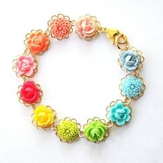 http://www.etsy.com/listing/60576351/color-wheel-bracelet?ref=sr_gallery_30_search_query=bright+flower_search_type=handmade_facet=handmade