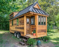 Farmhouse Chic: The Cedar Mountain Tiny House, built by Nashville-based New Frontier Tiny Homes, might look small on the outside, but inside, it's big on farmhouse-style design. Click through to discover more impressive tiny homes. Plan Tiny House, Tiny House Exterior, Best Tiny House, Tiny House Cabin, Tiny House On Wheels, Micro House, Tiny House Trailer, Car Trailer, Wooden House Design