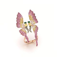 A rose gold butterfly ring by Wendy Yue set with yellow sapphires, tsavorites, pink sapphires, golden diamonds, white diamonds and champagne diamonds. be inspired by the power women designers of jewellery: http://www.thejewelleryeditor.com/window-shopping/jewellery-for-her/wendy-yue-sapphire-tsavorite-diamond-butterfly-ring/ #jewelry #nature