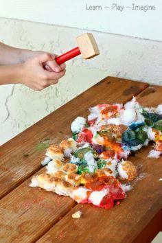 Smashing baked cotton balls - combining art and gross motor skills!