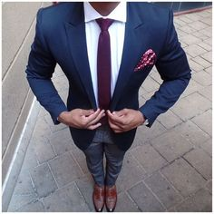 If you're searching for a silhouette that you can rely on on a day off, look no further than this combination of a dark blue blazer jacket and dark blue check suit pants. Elevate this ensemble with brown leather tassel loafers.   Shop this look on Lookastic: https://lookastic.com/men/looks/blazer-dress-shirt-dress-pants/18848   — White Dress Shirt  — Dark Purple Knit Tie  — Purple Polka Dot Pocket Square  — Navy Blazer  — Black Leather Watch  — Navy Check Dress Pants  — Brown Leather Tassel…