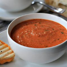 A healthy homemade Creamy Tomato Basil Soup perfect for dunking those crunchy grilled cheeses in!