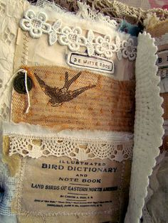 Amazing fabric journal on the theme of birds----- I've been looking at fabric journals this morning and feel really inspired. I might use a bit of that inspiration to go make a little needle book with all the scraps of lace I have hidden away.
