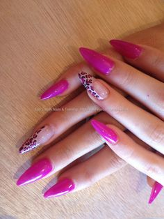 Stiletto nails with pink/purple gel polish with leopard print on ring finger