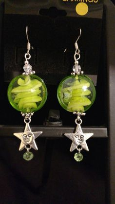 Check out this item in my Etsy shop https://www.etsy.com/listing/399622809/green-lampwork-glass-with-stars-earrings