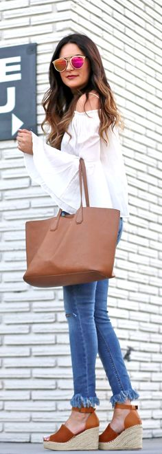 Click here for the details on this affordable outfit! | Fashion blogger Mash Elle styles Steve Madden Espadrilles with Express ripped cropped jeans, a Forever 21 white off the shoulder shirt, Free People aviators and Tory Burch perry tote.