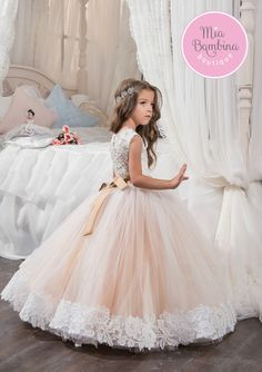 She will look radiant at your wedding in this Huntington flower girl dress. This sleeveless girls dress features a sheer illusion jewel neckline embellished with shiny rhinestones, gorgeous lace overlay fitted bodice, lace over tulle hemline, and a rhinestone brooch accent at waist. The dress has a buttoned up back for a perfect fit.