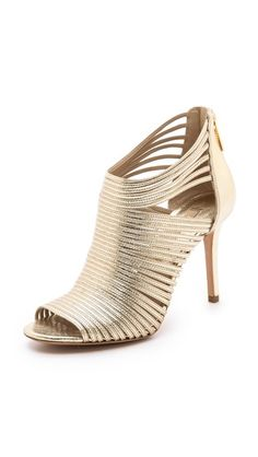 And then there's always a gold shoe. Love a gold shoe. Michael Kors Collection Maxi Metallic Sandals