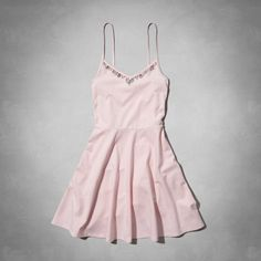 supersoft fabric with a little stretch, fitted through the top with a full circle skirt, embellished neckline, skinny straps, skater fit, imported<br><br>94% cotton / 6% elastane