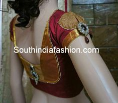 Maroon and gold silk saree blouse with stylish back neck pattern embellished with brooches on the back and over the sleeves. Related PostsKundan Work Wedding BlouseWedding Saree Blouse DesignsBridal Lehenga Blouse by Varuna JitheshBridal Saree Blouse by Divya's